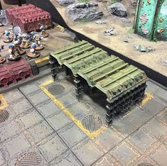 Some more novel scenery from Warhammer World. Love the sheds made from the containers. #40k #scenery #modelmaking #terrain