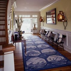 A great area rug can put a new look underfoot without the hassle or high cost of new flooring. | Coastalliving.com