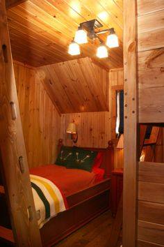 This cozy bedroom is designed for kids when the family heads to the lake home. Built in bunk beds are on the right and a ladder on the left to access a loft above, all make for a great space for the kids. A funny story about the ladder to the loft. When the homeowner was checking it out for the first time there was a small squeak when using the ladder. I apologized for the squeak and that it would be fixed. She replied that she wanted it left just like that. It is all part of the cabin feel.