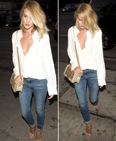 Jeans with a white blouse, nude heels, and a Chanel bag.