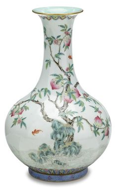 Fine Chinese famille rose 'peach and bat' porcelain vase,  Daoguang mark and of the period.  Bottle form, turquoise interior lappet band to gilded rim, over body well enameled to show peach and iron-red Fu bats, over scrolling sea, blue scroll glazed foot rim, iron red mark on light blue ground to base. #FreemansAuction
