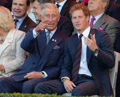 Father and son:  Prince Charles points something out to Prince Harry.  Invictus games Sept. 2014