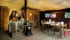 The Feather Down tents are located down a gentle hill from the historic red barn (which holds the Farm Store), in a shady green hollow right near the farm's namesake — a meandering Stony Creek. The hamlet of tents encircle an inviting communal campfire