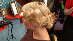 Amazing retro wedding hair, wave on side and beautifully pinned curls at the back.