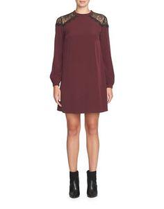 "<ul><li>Chic silhouette topped with lace shoulder details</li> <li>Banded round neckline</li> <li>Long blouson sleeves with buttoned cuffs</li> <li>Back self-tie</li> <li>Lined</li> <li>About 36"" from shoulder to hem</li> <li>Polyester</li> <li>Machine wash</li> <li>Imported</li><li>This item will arrive with a tag attached and instructions for removal. Once tag is removed, this item cannot be returned.</li></ul>"