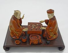 Two men attempt to master the Game of Go ~ Japanese Meiji Okimono Wood and Ivory, group of two men playing a board game - c. Meiji (1868-1912), Japan via Amulet Art and Antiques