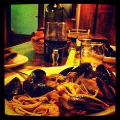 Spaghetti & mussels and a glass of red wine in a tipical restaurant of Capoliveri village, Elba island, Italy