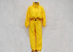 Vintage 80s 90s Yellow One Piece Ski Suit Yellow Ski Suit Yellow Snowboarding Yellow Snowsuit Jumpsuit Small Size Label Size: 36 Please look the actual measurements in description which are taken by hand and thus show the actual size. Measurements (lying flat): Overall length: