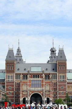 """This is the famous Rijksmuseum, the national museum of Holland, housing art and history from the Middle Ages to today. It's a spectacular space, but I think people are even more in love with the """"I amsterdam"""" sign in the front of building. Selfies galore. Sigh. #refinery29 http://www.refinery29.com/honeymoon-destinations#slide-9"""