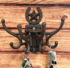 """• This Western Lone Star With Horsehoe Swivel Wall Hooks measures 7""""High 2""""-9.75"""" Wide And 5.25""""Deep approximately. It weighs about 2.25 pounds.• This Western Lone Star With Horsehoe Swivel Wall Hooks is made of designer sturdy cast iron, hand painted and polished individually in rustic bronze finish.• Elevate your home decor with this rustic style Western Star Horseshoe free spinning swivel wall hooks. Made of cast iron, these sturdy and stylish wall hook sculpture will organize your keys, coat Hat Hanger, Hanger Hooks, Wall Hooks, Hangers, Cast Iron, It Cast, Cowboy And Cowgirl, Antique Metal, Rustic Style"""