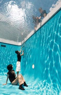 swimming pool illusion  A large, continuous piece of acrylic spans the pool and suspends a few inches of water above it, creating the illusion of a standard swimming pool
