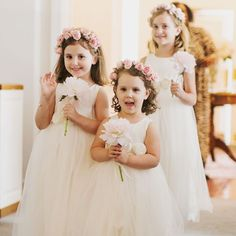 Rebekah's flower girls each wore the same ivory tulle dress, had flower headbands with mini carnations and spray roses, and carried a single blush peony.