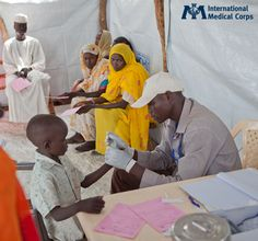 July 29:  A child receives a checkup in Maban County, South Sudan. Photo: Melissa Riggs, International Medical Corps, South Sudan 2012