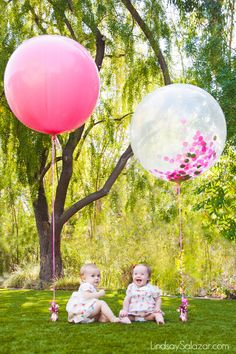 Twin girls 1st birthday party! These giant balloons are amazing for photos. LindsaySalazar.com