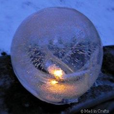 How cool are these Fire and Ice Luminaries?  Made by freezing water balloons, these ice luminaries are perfect for parties and evening gatherings.  Try coloring the water before putting it in the balloon for a neat effect!