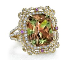 "Erica Courtney's 18k rose gold size 7 ring set with a 19.19ct Zultanite stone. This unique piece measures 1"" long & is pave set with 1.98ctw diamonds & features 4 pink sapphires = .31ctw"