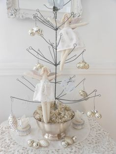 Evelyn and Rose: Christmas House Tour - Dining Room  Adore this little wire tree!!