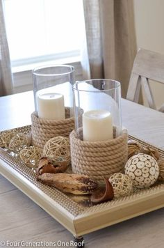 """See how I made my own sisal candle holders and used these from HomeGoods as my inspiration. Wrapping sisal around a glass candle holder is a great way to """"get the look"""" on a budget. What a great coastal centerpiece! Rope Crafts, Beach Crafts, Beach House Decor, Diy Home Decor, Room Decor, Diy Rustic Decor, Decor Crafts, Diy Crafts, Deco Marine"""