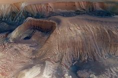 best photos of space hebeschasma mosaic. Martian mesas Hebes Chasma is an enclosed trough on the Martian surface. Nearly 8000 meters deep in some places, the area is often called the Grand Canyon of Mars. Scientists believe melting ice may have played a large role in its formation.