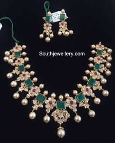 22 carat gold floral necklace adorned with polki diamonds, emeralds, rubies and south sea pearls paired with matching earrings. White Gold Jewelry, Emerald Jewelry, Emerald Necklace, Necklace Set, Gem Necklaces, Floral Necklace, Bridal Necklace, Gold Jewellery Design, Antic Jewellery