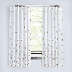 Make a toast to the best polka dotted curtains around. These Champagne Dot Curtains feature a bronze dot pattern all over and are made from 100% cotton voile. Cheers.