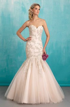 Crystalline details and a slightly asymmetric bodice add a touch of whimsy to this strapless gown. Allure Bridal Spring 2016 wedding dress collection.