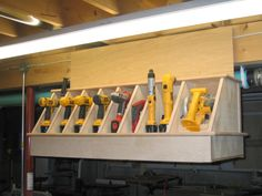 I wanted a place to safely hold my cordless tools. I was constantly knocking my cordless drill/drivers off the top of my workbench so I designed and built this. I know there are countless variations of holders like this, but I wanted something...