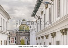 Low angle view of eclectic style buildings at the historic center of Quito in Ecuador.