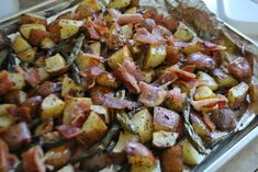 """""""Potato Green Bean Bacon Bake""""--  I made this recipe tonight for dinner, but I really didn't follow the recipe.  I cut the beans and potatoes up like the recipe suggested, tossed them in a gallon size bag with EVOO, garlic salt, pepper, and some regular salt.  Then I put them on a baking sheet and put some raw julienned bacon on top.  I baked it at 350* for one hour, stirring half way."""