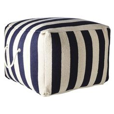 Add this striped pouf to rest your feet after a long day of beachcombing. It's the perfect place to relax and enjoy that glass of wine! #beach #home