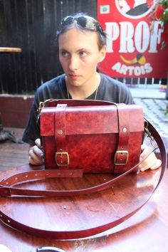 The first hand made item by Steam Generation this antique red leather bag  Made using 3.5mm veg tan leather, brass rivets / buckles, hand dyed