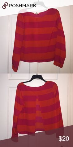 Hot pink and orange striped blouse Long sleeve hot pink and orange striped blouse by Cope. Open back. Very cute on! Tops Blouses