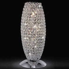Diyas Kos 3 Light Chrome Crystal Table Lamp An elegant, polished chrome table lamp that is complimentary to many other fittings in the Diyas range. Glass Table Lamp, Crystal Table Lamps, Crystal Lighting, Lamp, Chrome Table Lamp, Modern Table Lighting, Cordless Table Lamps, Bedside Lamp Modern, Chrome Light Fixture