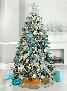 But if you truly want to stand out, we'd suggest you go for a blue Christmas tree this year. we've gathered a list of blue Christmas tree decoration ideas. Teal Christmas Tree, Blue Christmas Tree Decorations, Turquoise Christmas, Christmas Tree Design, Beautiful Christmas Trees, Elegant Christmas, Noel Christmas, Rustic Christmas, White Christmas