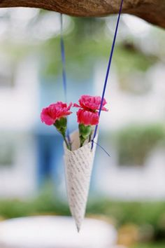 Cones - Place a few stems into petite paper cones and hang with ribbon {Shipra Panosian Photography}
