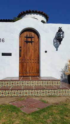 Spanish tile details the stair risers on this inviting entry.