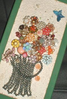 Make Costume Jewelry Artwork Collage for your wall: An easy and creative way to make art from your costume or junk jewelry (any outdated cheap stuff) - or any other small items that are appealing to you (marbles, small toys, misc. doodads found in your junk drawer?)