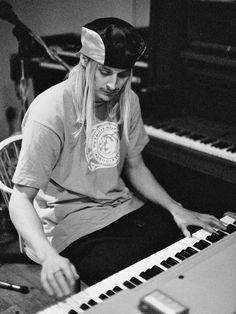 Kid Rock tinkering on the piano at White Room Studios in March 1995. Description from cincinnati.com.