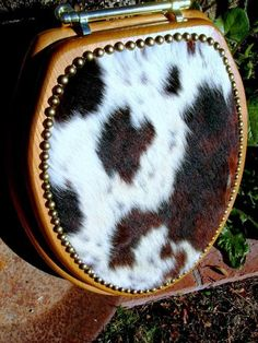 Western flair without too many bells and whistles, here is a classic cowhide covered Toilet seat cover