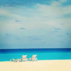 Cancun, Mexico - white sand beaches that never get hot on your feet, aqua waters & blue skies.