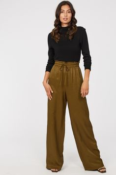 Update your everyday look with the Maya Wide Leg Pant. Made using a viscose/linen blend, the Maya is a wide leg, high waisted pant with a drawstring waist and front pockets to give a slouchy finish. Pair the Maya with our Harry merino turtleneck and your fave heels for a chic look or a basic tee and some sneakers to keep it effortlessly cool. Viscose Linen Wide leg High waisted Drawstring Material: 80% VISCOSE 20% LINEN Everyday Look, Drawstring Waist, Wide Leg Pants, Turtleneck, Maya, Work Wear, Parachute Pants, Ootd, It Is Finished