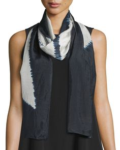 Eileen Fisher light and airy shibori scarf, available in your choice of color. Multiple ways to drape, wrap, and knot. Silk. Dry clean. Imported.