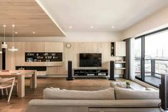 A modern apartment celebrates the looks of natural wood
