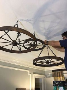 wagon wheel chandelier, how to, repurposing upcycling, wall decor