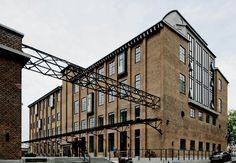 Henkel was originally a soap factory build in the 19. century. The factory has now been renewed and the old industry building is today used for offices and business. The transformation has been made with great respect for the inherent resiliency and raw historic expression, and the old fabric now appears as an attractive and modern business environment.   #Renovering #RENOVERprisen #Henkel #DanishDesign #Architecture #Scandinavia #Building