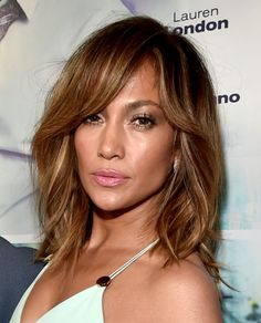 All about these swooshing sections of hair that delicately frame J.Lo's face.