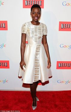 Lupita Nyong'o in Bibhu Mohapatra dress, Swarovsk clutch, Fred Leighton jewels, Christian Louboutin shoes - At the Google/Netflix White House Correspondents Party in Washington DC.  (May 2, 2014)