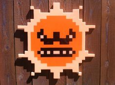 Angry Sun (wooden pixel art) by Jacob Ashley