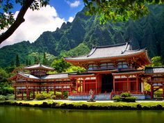 The Byodo-In Temple is located at the foot of the Ko'olau Mountains in Valley of the Temples Memorial Park. It was established on June 7, 1968, to commemorate the 100 year anniversary of the first Japanese immigrants to Hawaii. The Byodo-In Temple in O'ahu is a smaller-scale replica of the over 950-year-old Byodo-in Temple, a United Nations World Heritage Site in Uji, Japan.