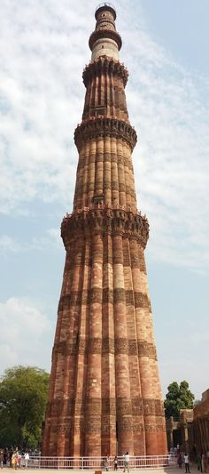 Qutub Minar. Notice Iltutmish covered his three floors (2nd, 3rd, 4th) in very different designs. Sandstone, buff, marble